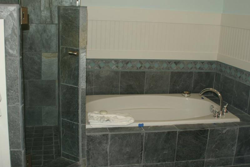 3rd floor master- tub & shower- slate & green glass tile