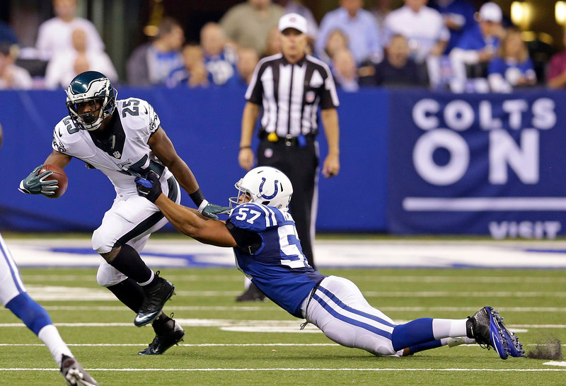 . Philadelphia Eagles running back LeSean McCoy (25) is tackled by Indianapolis Colts linebacker Josh McNary (57) during the first half of an NFL football game Monday, Sept. 15, 2014, in Indianapolis. (AP Photo/Michael Conroy)