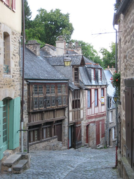 a winding street with medieval homes