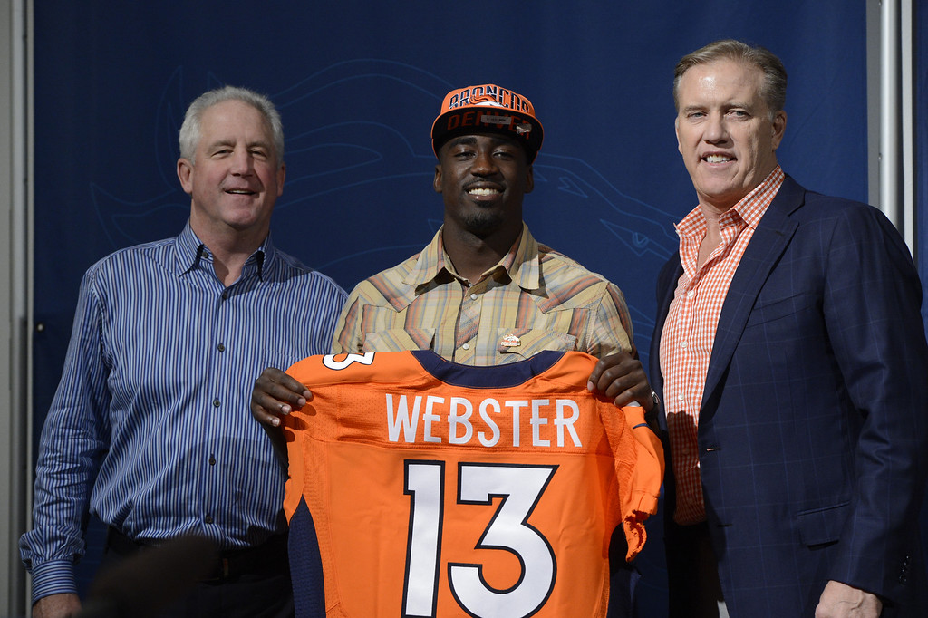 . ENGLEWOOD, CO. - APRIL 27: Denver Broncos Head Coach John Fox, left and Executive Vice President of Football Operations John Elway, right, introduce CB Kayvon Webster during a press conferences at the team�s training facility in Englewood, CO April 27, 2013. (Photo By Craig F. Walker/The Denver Post)