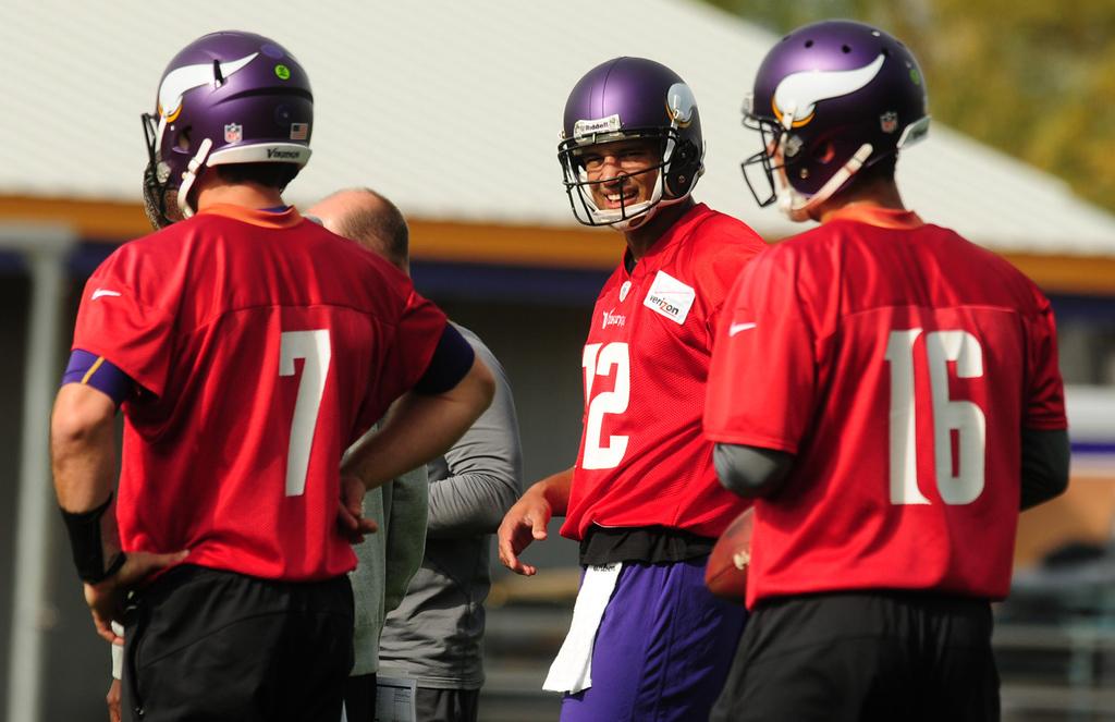 . Vikings quarterbacks (from left) Christian Ponder, Josh Freeman and Matt Cassel chat during Vikings practice on Thursday.  (Pioneer Press: Scott Takushi)