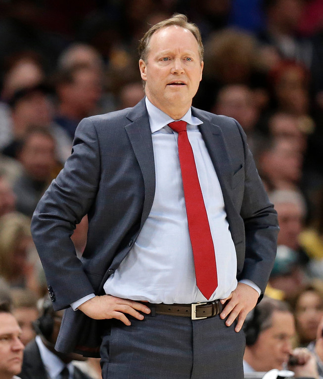 . Atlanta Hawks head coach Mike Budenholzer watches in the first half of an NBA basketball game against the Cleveland Cavaliers, Tuesday, Dec. 12, 2017, in Cleveland. The Cavaliers won 123-114. (AP Photo/Tony Dejak)