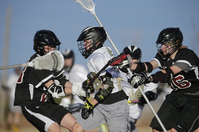 JPM0325-JPM0325-Jonathan first HS lacrosse game March 9th.jpg