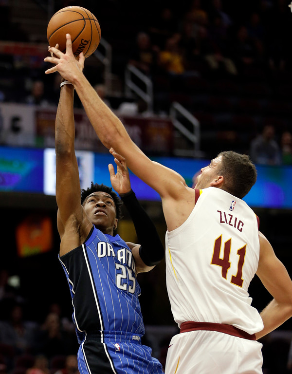 . Orlando Magic\'s Wesley Iwundu (25) drives to the basket against Cleveland Cavaliers\' Ante Zizic (41), from Croatia, in the second half of an NBA basketball game, Saturday, Oct. 21, 2017, in Cleveland. (AP Photo/Tony Dejak)