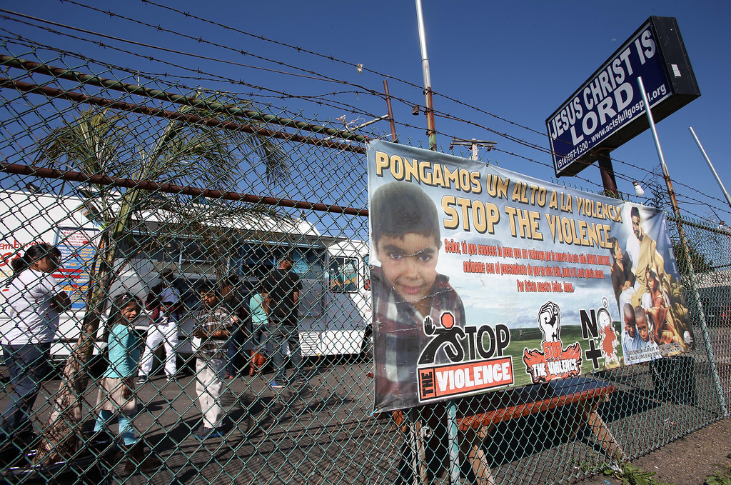 . An anti-violence poster with a picture of Gabriel Martinez Jr. is seen near a taco truck on International Boulevard at 55th Avenue in Oakland, Calif., on Thursday, April 18, 2013. Gabriel, 5, was shot and killed at his father\'s taco truck on the site in 2012.  (Jane Tyska/Staff)