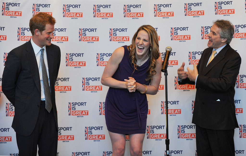 . Prince Harry, left, and British Ambassador Peter Westmacott, right, celebrate 18th birthday of Gold medal swimmer Missy Franklin, center, during the reception at Club House of Sanctuary Golf Course in Sedalia, Colorado. May 10, 2013. (Photo By Hyoung Chang/The Denver Post)