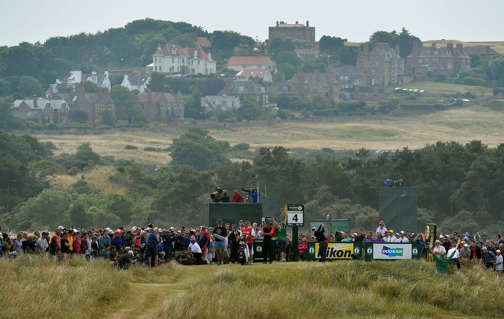 . Adam Scott of Australia watches his tee shot on the fourth hole during the final round of the British Open golf championship at Muirfield in Scotland July 21, 2013. REUTERS/Toby Melville