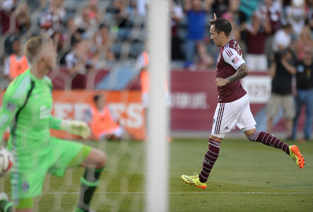 . COMMERCE CITY, CO - JUNE 28: Colorado forward Vicente Sanchez celebrated his goal off a penalty kick in the first half. The Colorado Rapids defeated the Vancouver Whitecaps 2-0 at Dick\'s Sporting Goods Park Saturday night, June 28, 2014.  Photo by Karl Gehring/The Denver Post