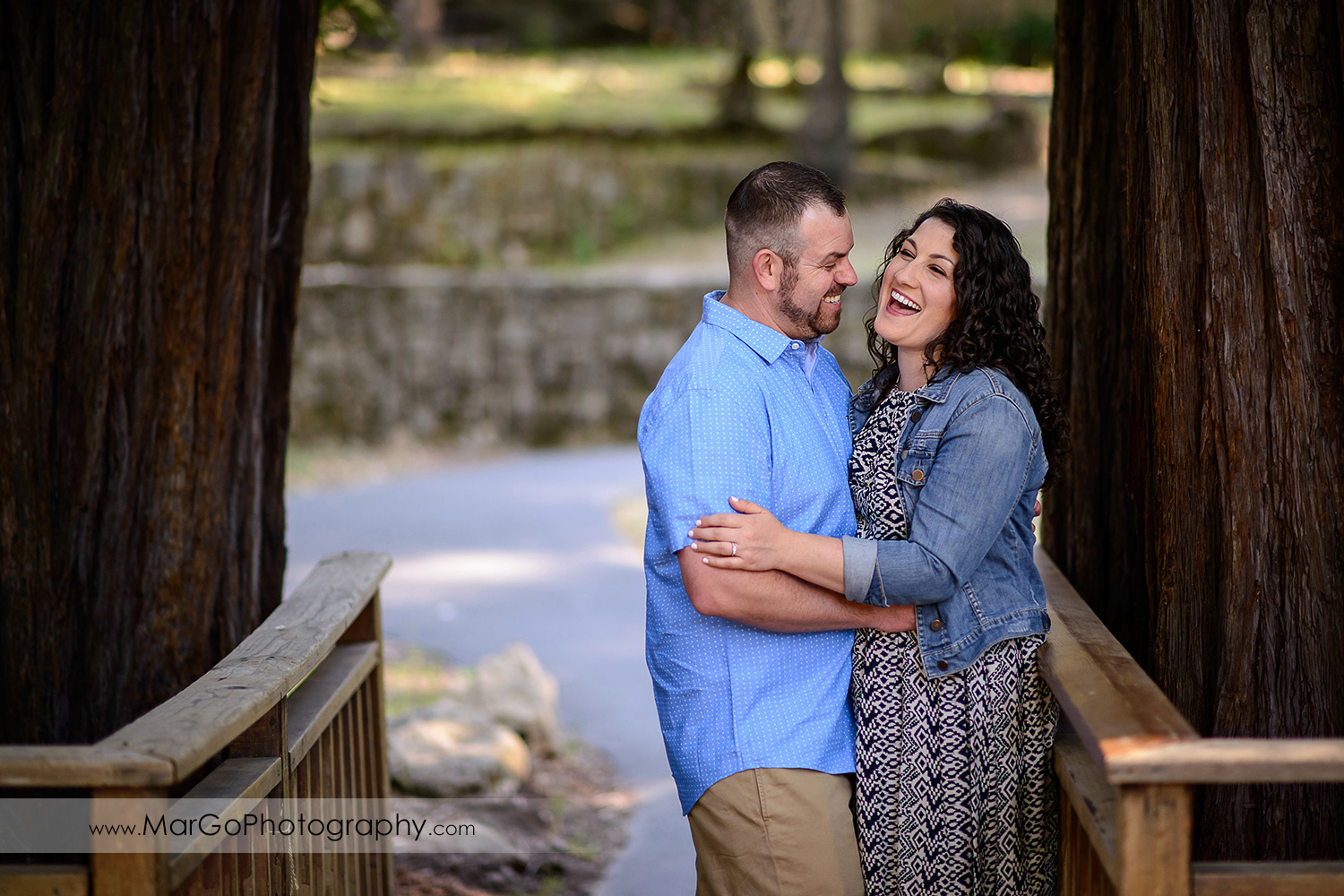 engaged couple laughing at Sanborn County Park