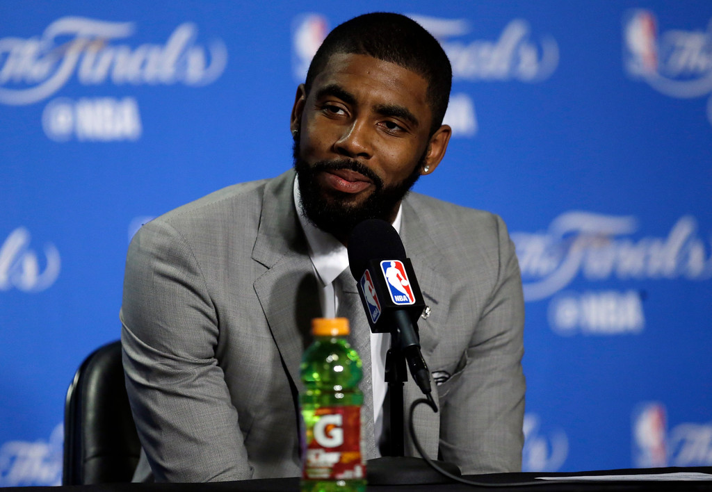 . Cleveland Cavaliers guard Kyrie Irving answers questions after Game 1 of basketball\'s NBA Finals against the Golden State Warriors Thursday, June 1, 2017, in Oakland, Calif. (AP Photo/Ben Margot)