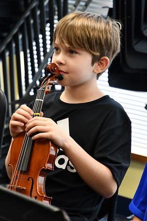 Setting the Bar High in Fifth-Grade Strings Class