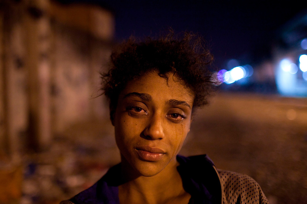 """. In this Aug. 7, 2012 file photo, Natalia Gonzales, a 15-year-old crack user, poses for a portrait in an area known as \""""Crackland\"""" in the Manguinhos slum in Rio de Janeiro, Brazil. This photo by Associated Press photographer Felipe Dana received an honorable mention for the Contemporary Issues singles category in the World Press Photo 2013 photo contest. (AP Photo/Felipe Dana, File)"""