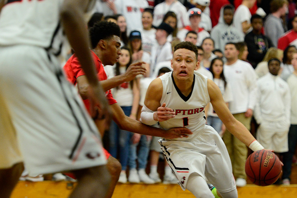 . CENTENNIAL, CO - MARCH 2: Colbey Ross of Eaglecrest (1) dribbles around the defense of Denver East during the second quarter at Eaglecrest High School on March 2, 2016 in Centennial, Colorado. Eaglecrest defeated Denver East 56-46. (Photo by Brent Lewis/The Denver Post)