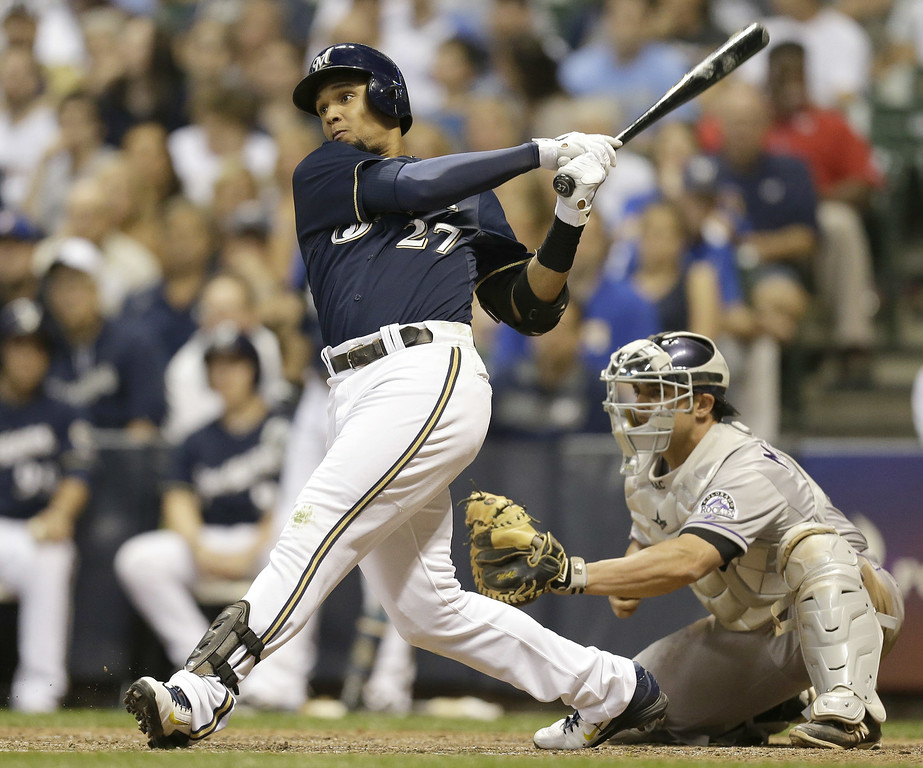 . MILWAUKEE, WI - JUNE 27: Carlos Gomez #27 of the Milwaukee Brewers hits a single in the bottom of the eighth inning against the Colorado Rockies at Miller Park on June 27, 2014 in Milwaukee, Wisconsin. (Photo by Mike McGinnis/Getty Images)