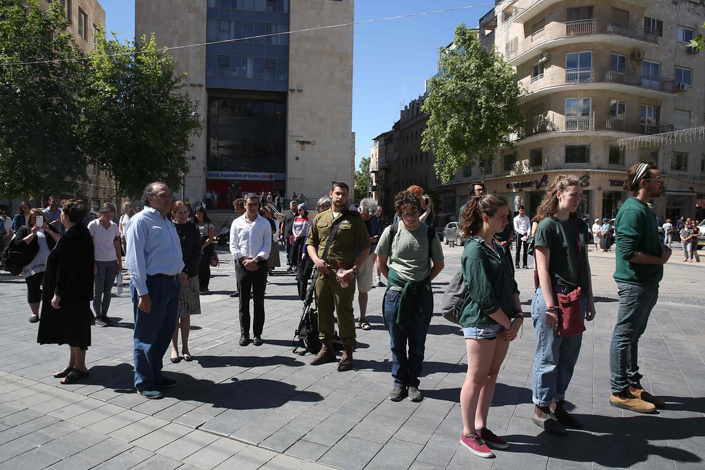 . Israelis stop and stand in silence in the centre of Jerusalem on May 5, 2016, as sirens wailed across Israel for two minutes marking the annual day of remembrance for the six million Jewish victims of the Nazi genocide. The Holocaust Remembrance Day commemorates the six million Jews killed by the Nazis during World War II, and is an internationally recognized date corresponding to the 27th day of Nisan on the Hebrew calendar which begins this year in the evening of May 4 and ends in the evening of May 5. / AFP PHOTO / MENAHEM KAHANA/AFP/Getty Images