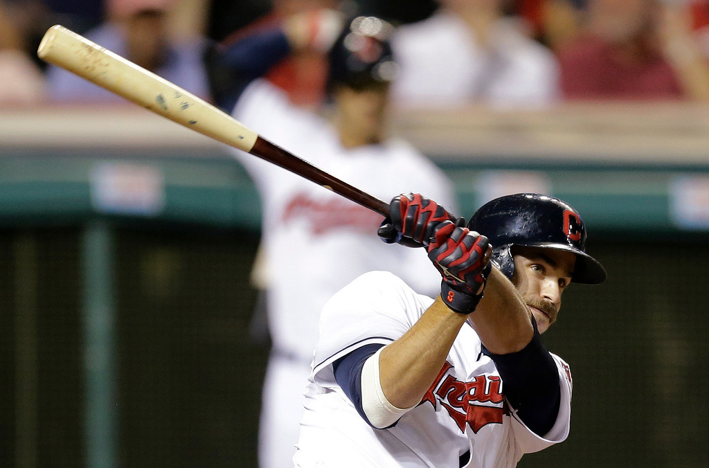 . Cleveland Indians\' Lonnie Chisenhall hits an RBI single off Detroit Tigers starting pitcher Max Scherzer in the sixth inning of a baseball game, Thursday, Sept. 4, 2014, in Cleveland. Jason Kipnis scored on the play, and Chisenhall advanced to second. (AP Photo/Tony Dejak)