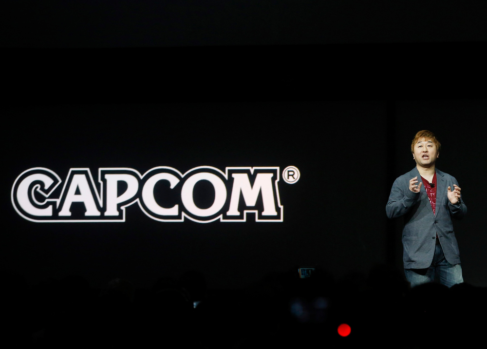 . Yoshinori Ono of Capcom speaks during the PlayStation 4 launch event in New York, February 20, 2013. REUTERS/Brendan McDermid