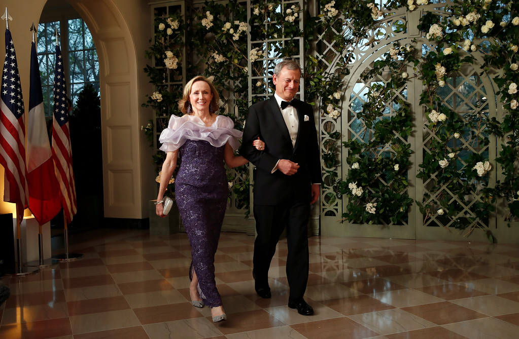 . Supreme Court Justice Chief Justice John Roberts and his wife Jane Roberts arrive for a State Dinner with French President Emmanuel Macron and President Donald Trump at the White House, Tuesday, April 24, 2018, in Washington. (AP Photo/Alex Brandon)