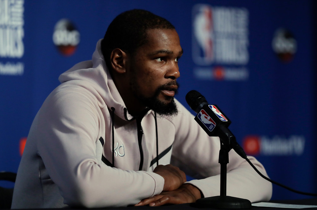 . Golden State Warriors forward Kevin Durant speaks during a news conference following Game 3 of basketball\'s NBA Finals, early Wednesday, June 7, 2018, in Cleveland. The Warriors defeated the Cleveland Cavaliers 110-102 to take a 3-0 lead in the series. (AP Photo/Tony Dejak)