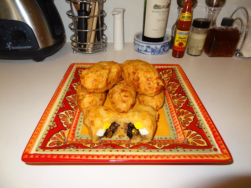 Papa rellenas - fried, stuffed mashed potatoes. Russet and sweet potatoes, ground beef, sauteed onions & garlic, Spanish paprika, spiced Moroccan olives, golden raisins and sliced hard boiled eggs.