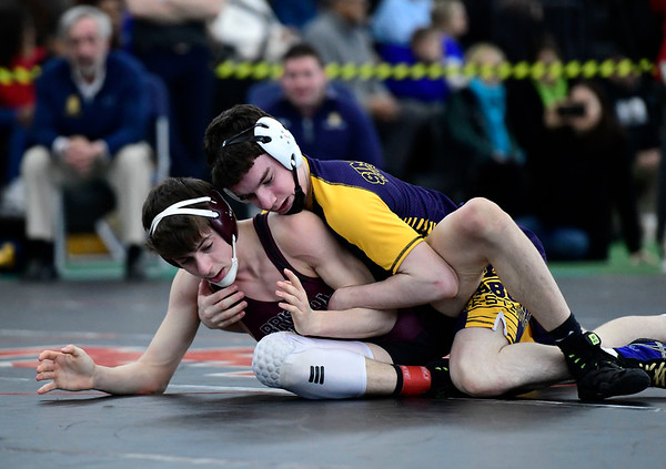 2/22/2019 Mike Orazzi | Staff Bristol Central's Jason Feto and Simsbury's Saul Pera in a 132 pound match during the CIAC State Open Wrestling Tournament at the Floyd Little Athletic Center in New Haven Saturday.