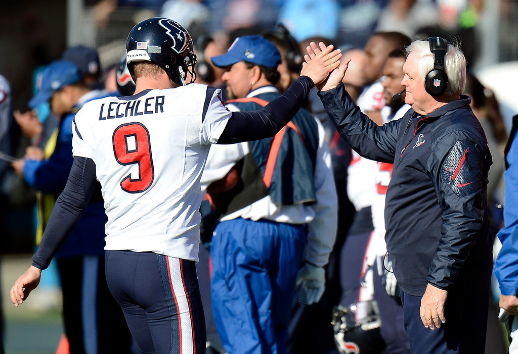 . Houston Texans interim head coach Wade Phillips, right, congratulates punter Shane Lechler (9) after a kick against the Tennessee Titans in the second quarter of an NFL football game Sunday, Dec. 29, 2013, in Nashville, Tenn. (AP Photo/Mark Zaleski)