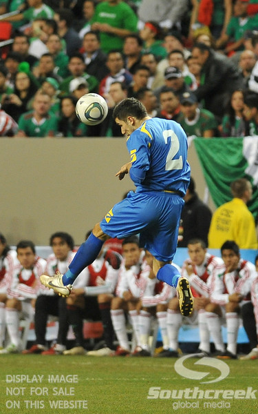 Bosnia-Herzegovina's Defender Mensur Mujdza (#2) heads the ball during Soccer action between Bosnia-Herzegovina and Mexico.  Mexico defeated Bosnia-Herzegovina 2-0 in the game at the Georgia Dome in Atlanta, GA.