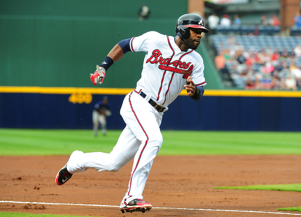 . Jason Heyward #22 of the Atlanta Braves rounds third base to score a first inning run against the Colorado Rockies at Turner Field on July 31, 2013 in Atlanta, Georgia. (Photo by Scott Cunningham/Getty Images)