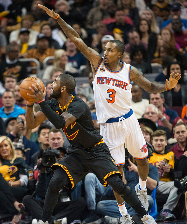 . New York Knicks\' Brandon Jennings (3) guards Cleveland Cavaliers\' Kyrie Irving during the second half of an NBA basketball game in Cleveland, Tuesday, Oct. 25, 2016. The Cavaliers won 117-88. (AP Photo/Phil Long)