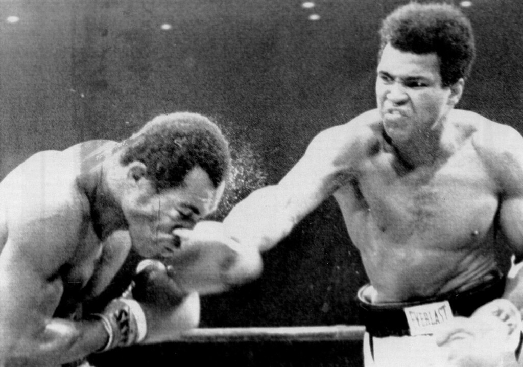 . Muhammad Ali scores with a solid right to the head of ken Norton as he goes on to win a split decision. Ali was defeated 5½ months ago by Norton in San Diego when he broke the jaw of Ali.1973. Denver Post Library photo archive