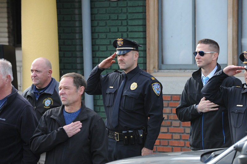 "Phillipsburg Police Captain Travis Zechman salutes during the ceremony. The Phillipsburg Police Department held a remembrance ceremony honoring fallen officer, Kenneth W. ""Red"" Vandegrift who died in the line of duty Nov. 20, 1930. The ceremony was at the bridge on South Main Street that bears his name."
