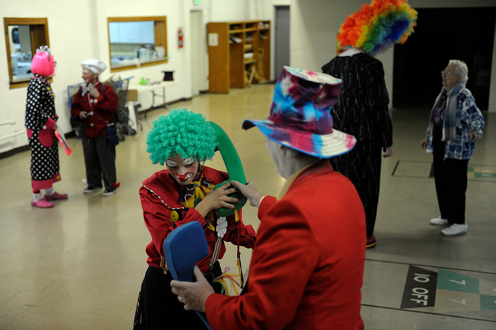 . Kalvinator, aka Donald Nash, right, lets Pepper Doodle, aka Sandy Duran, answer one of his oversized phones as they prepare to rehearse a skit during Clown Class at First Presbyterian Church in Englewood on Sunday, March 3, 2013. The Colorado Clowns presented the 10-week series of clown classes that taught participants how to apply make up, character development, skits, parades and the history of clowning. Seth A. McConnell, YourHub