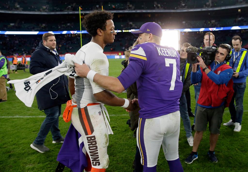 . Minnesota Vikings quarterback Case Keenum, right, talks with Cleveland Browns quarterback DeShone Kizer, left, after an NFL football game at Twickenham Stadium in London, Sunday Oct. 29, 2017. The Vikings won 33-16. (AP Photo/Tim Ireland)
