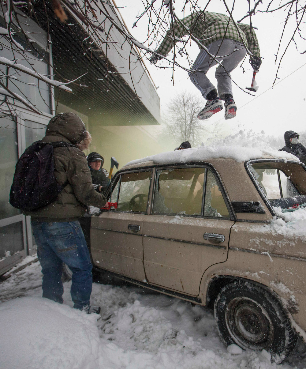 . In this photo taken on Friday, March 15, 2013, members of a pro-Kremlin youth group attack pushers of spice, a synthetic drug, in Moscow, Russia. Russian officials and anti-drugs campaigners say that spice has become one of the most dangerous drugs widely available to youngsters and almost impossible to ban because of the constantly changing chemical ingredients. (AP Photo/ Alexander Zemlianichenko Jr)
