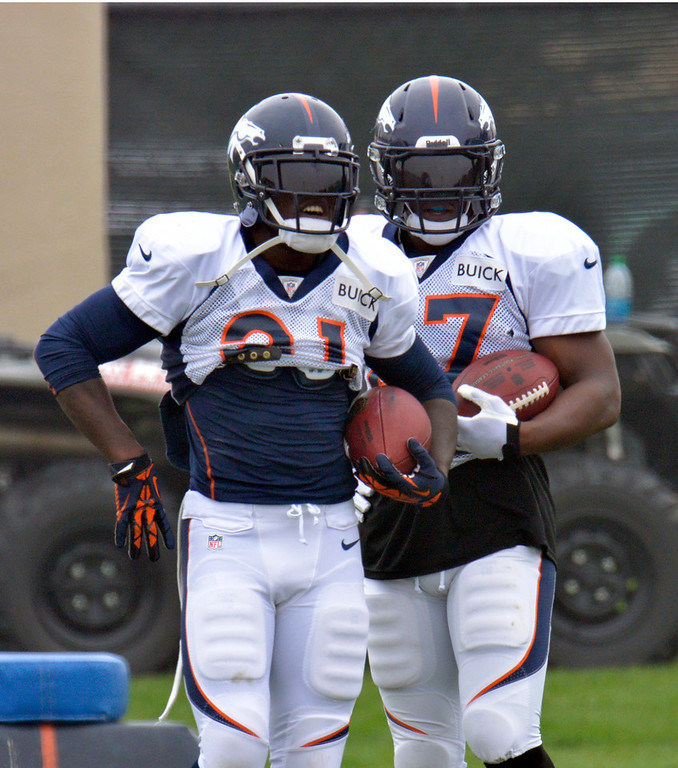 . Denver Broncos RB Ronnie Hillman (21) and Knowshon Moreno (27) wait their turn at drills  during training camp July 29, 2013 at Dove Valley. (Photo By John Leyba/The Denver Post)
