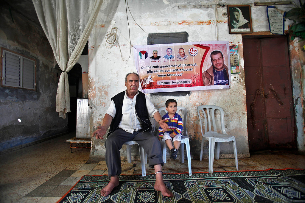 . Issa Masoud, 75, center, father of Omar, 40, who was arrested in May 1993 for killing an Israeli lawyer, reacts during an interview at his family house at Shati Refugee Camp in Gaza City on July 26, 2013. Israel\'s Cabinet is to decide Sunday whether to release dozens of long-term Palestinian prisoners as part of U.S. Secretary of State John Kerry\'s attempt to restart Israeli-Palestinian talks after five years of diplomatic paralysis.  (AP Photo/Adel Hana)