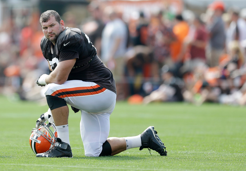 . Cleveland Browns tackle Joe Thomas rests during practice at the NFL football team\'s training camp Tuesday, Aug. 5, 2014, in Berea, Ohio. (AP Photo/Tony Dejak)