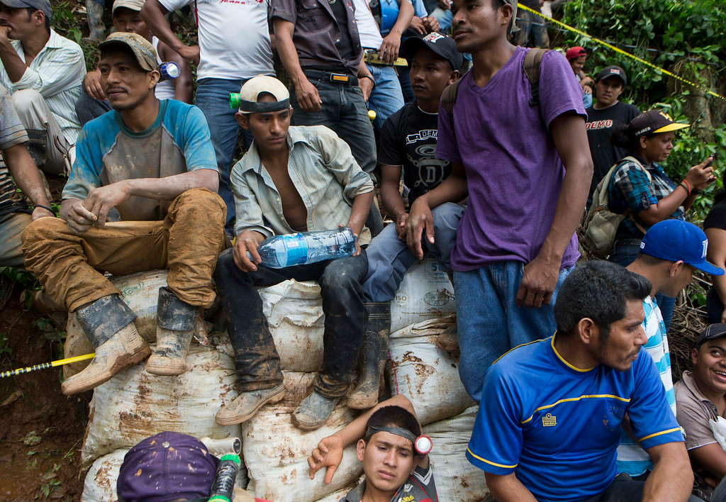 . Miners wait for their turn to help in the rescue operations at El Comal gold and silver mine after a landslide trapped at least 24 miners inside, in Bonanza, Nicaragua, Friday, Aug. 29, 2014. Rescuers on Friday located 20 of at least 24 gold miners trapped by a landslide in northern Nicaragua, but were not immediately able to bring them to safety. (AP Photo/Esteban Felix)
