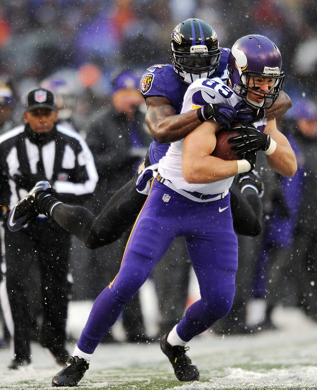 . Minnesota Vikings tight end John Carlson (89) tries to break free from Baltimore Ravens strong safety James Ihedigbo as he rushes the ball in the second half of an NFL football game, Sunday, Dec. 8, 2013, in Baltimore. (AP Photo/Gail Burton)