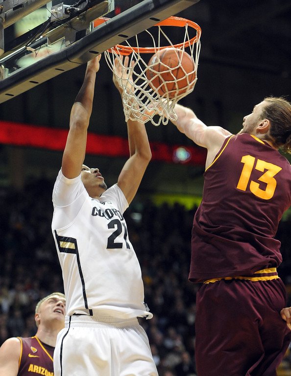 . Colorado\'s Andre Roberson, left, dunks against Arizona State\'s Jordan Bachynski during the first half of an NCAA college basketball game on Saturday, Feb. 16, 2013, in Boulder, Colo. (AP Photo/Daily Camera, Cliff Grassmick)