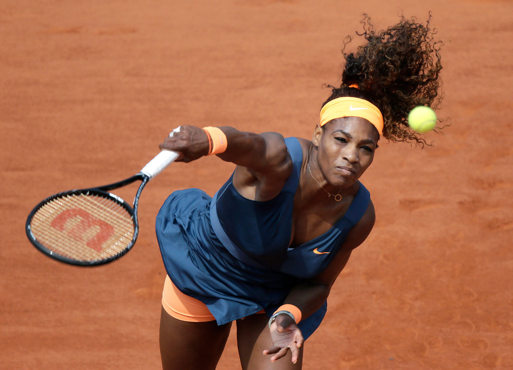 . USA\'s Serena Williams serves to Russia\'s Maria Sharapova during the 2013 French tennis Open final at the Roland Garros stadium in Paris on June 8, 2013. AFP PHOTO / KENZO TRIBOUILLARD/AFP/Getty Images