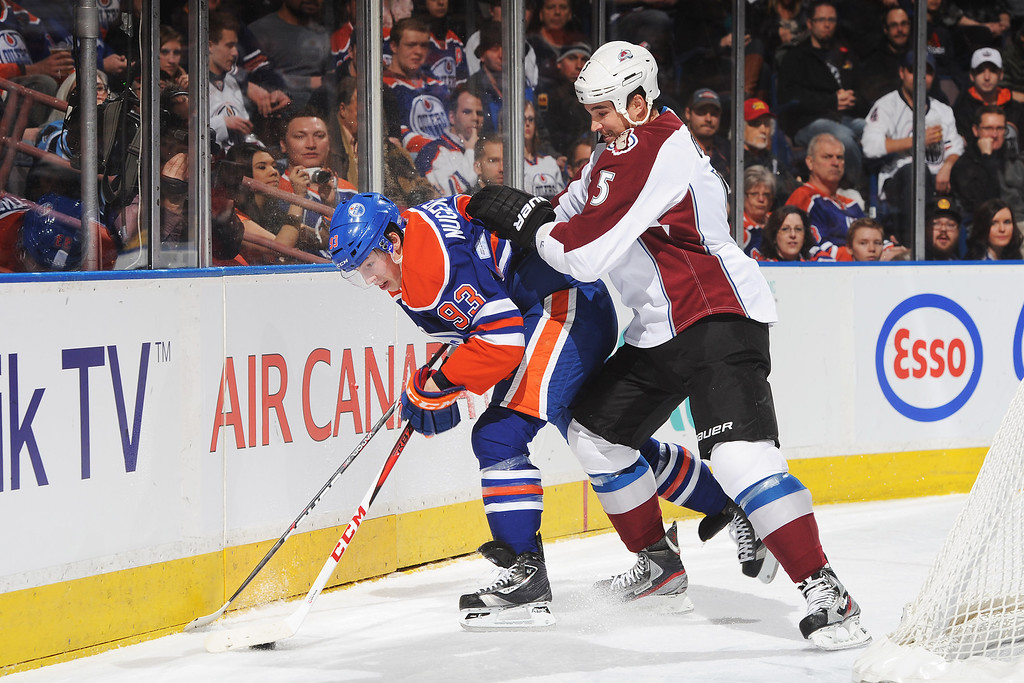 . EDMONTON, CANADA - FEBRUARY 16: Shane O\'Brien #5 of the Colorado Avalanche checks Ryan Nugent-Hopkins #93 of the Edmonton Oilers during the NHL game at Rexall Place on February 16, 2013 in Edmonton, Canada. (Photo by Derek Leung/Getty Images)