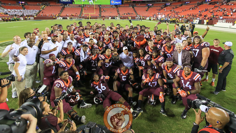 The Hokies pose for a group photo on the field. (Mark Umansky/TheKeyPlay.com)