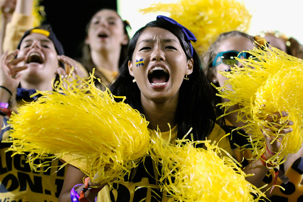 . ANN ARBOR, MI - SEPTEMBER 07: Michigan Wolverines fans cheer during the game against the Notre Dame Fighting Irish at Michigan Stadium on September 7, 2013 in Ann Arbor, Michigan.  (Photo by Gregory Shamus/Getty Images)
