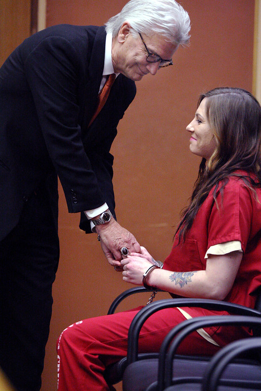 . Defense attorney Jerry Christiansen greets his client, Alix  Tichelman Tuesday in court when Tichelman changed her plea to guilty and was sentenced to six years in jail, most of which will not be served.  (Dan Coyro -- Santa Cruz Sentinel)