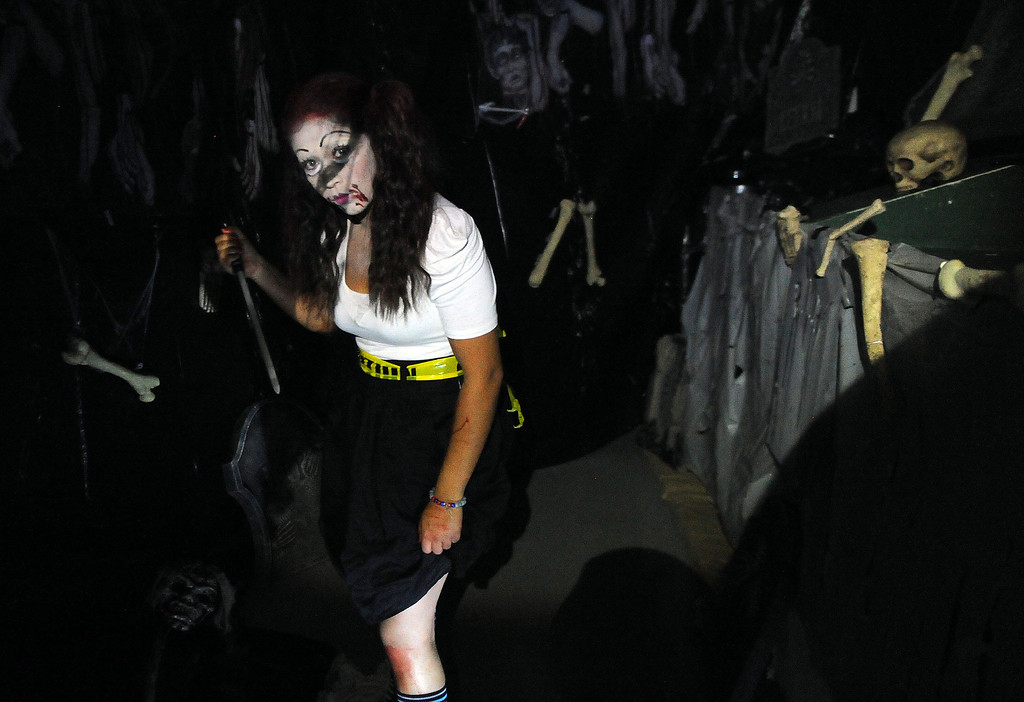. A woman carrying a knife prepares to scare the house guests during the annual Open House and Haunted Jail at Norwalk Sheriff Station in Norwalk, Calif., on Saturday, Oct. 19, 2013. Sheriff department\'s Aero Bureau, SWAT, Arson Explosives Detail, Recruitment unit, along with the L.A. County Fire Department, U.S. Army with a military vehicle, CHP, and the Sheriff\'s Department dragster were on display.  (Keith Birmingham Pasadena Star-News)