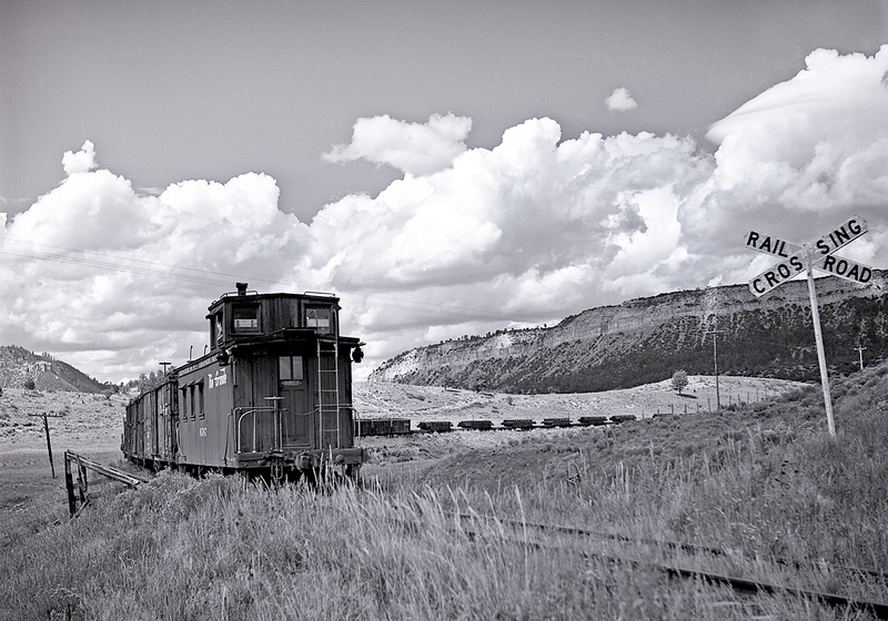 Heading west into Monero Canyon.  The train has just crossed Highway 84.  Date unknown.