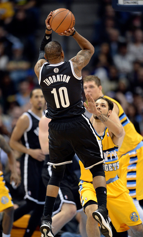 . DENVER, CO. - FEBRUARY 27, 2014: Denver guard Evan Fournier defended Marcus Thornton in the first half. The Denver Nuggets hosted the Brooklyn Nets at the Pepsi Center Thursday night, February 27, 2014. Photo By Karl Gehring/The Denver Post