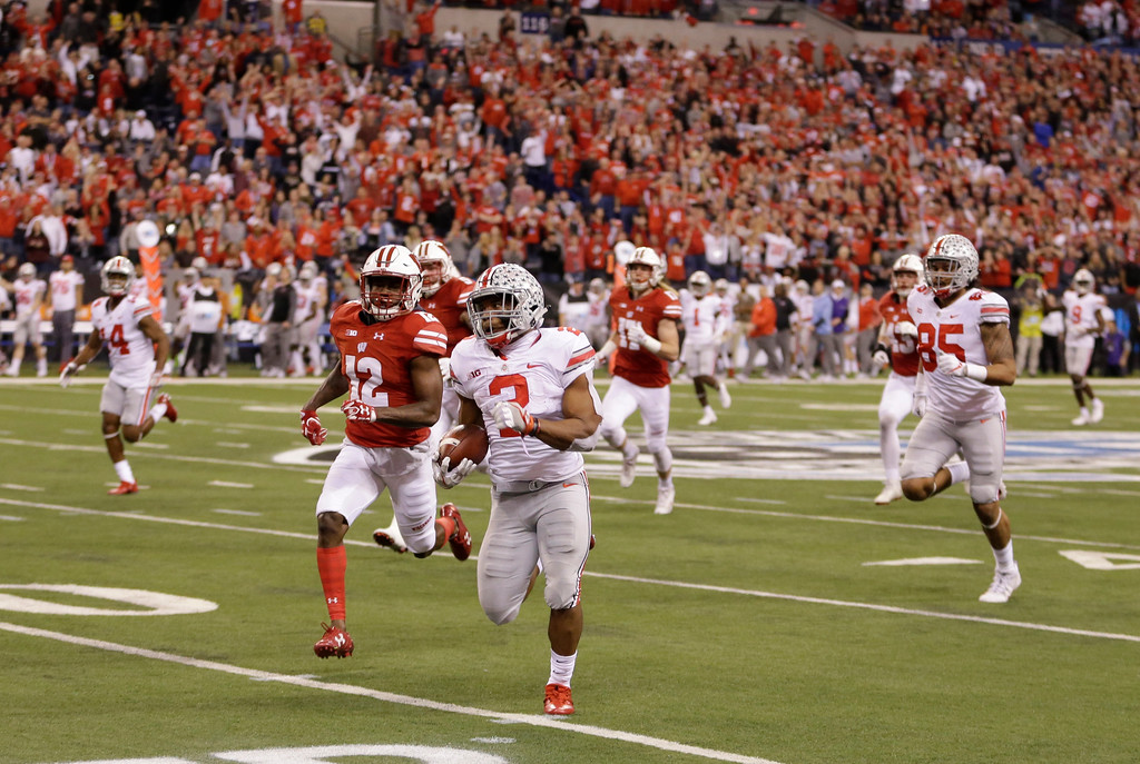 . Ohio State running back J.K. Dobbins (2) is chased by Wisconsin\'s Natrell Jamerson (12) during the second half of the Big Ten championship NCAA college football game, Saturday, Dec. 2, 2017, in Indianapolis. (AP Photo/AJ Mast)