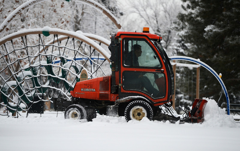 . A snowplow driver clears snow through the playground area of Observatory Park in Southeast Denver of Friday morning,  January 31, 2014. (Photo By Andy Cross / The Denver Post)